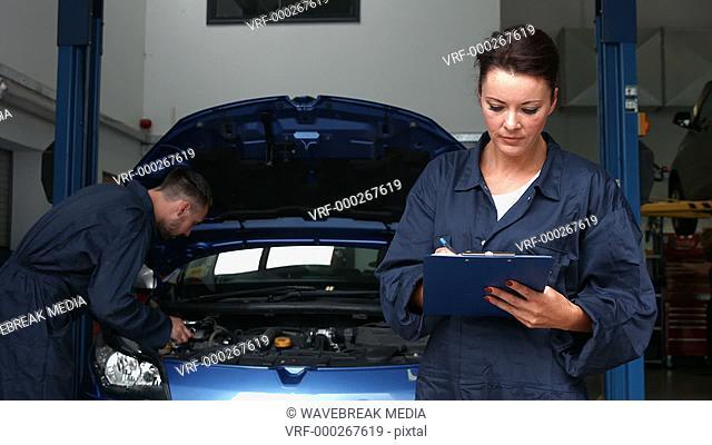Mechanics overhauling an engine