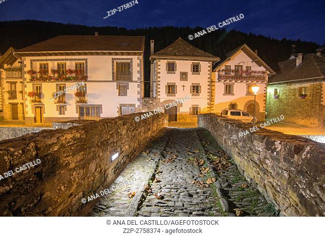 The picturesque village of Ochagavía, right in the middle of Navarre's Eastern Pyrenees Spain Nightscape on the stone bridge