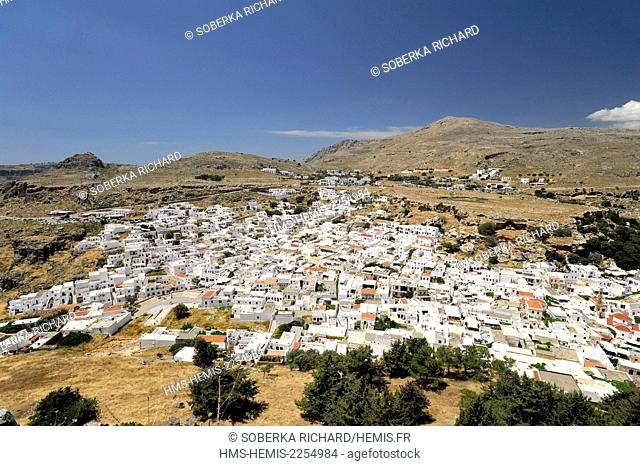 Greece, Dodecanese Islands, Rhodes island, Lindos, village viewed from the Acropolis and Temple of Athena Lindia built in the 9th century BC