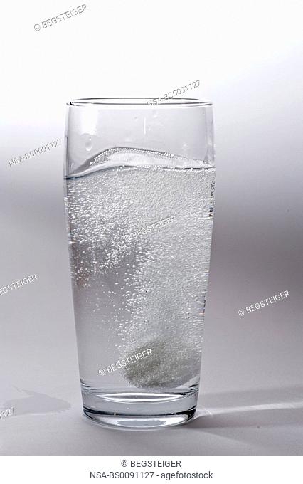 fizzy tablet in a glass of water