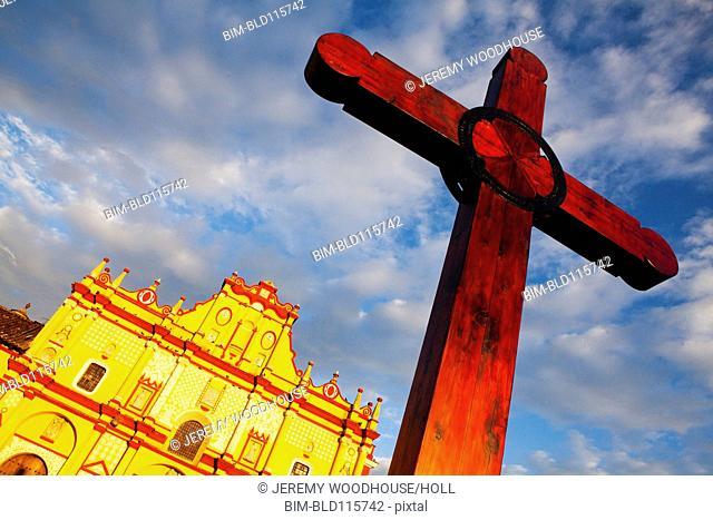 Low angle view of cross outside of church, San Cristobal de Las Casas, Chiapas, Mexico