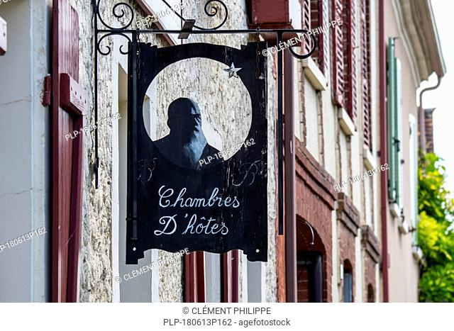 Sign showing silhouette of Impressionist painter Claude Monet at Le Coin des Artistes, chambre d'hôtes at Giverny, Eure department, Normandy, France