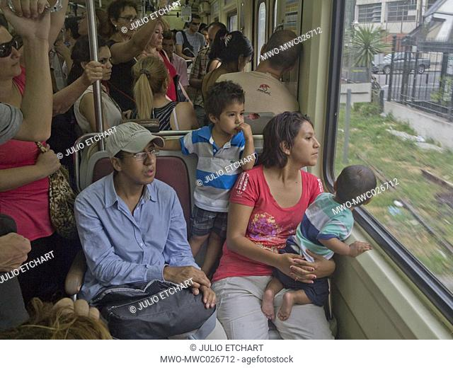 Passengers at a suburban train in Buenos Aires, Argentina