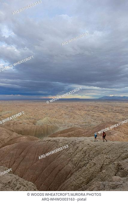 Adult couple hiking in badlands section of Anza Borrego State Park, California, USA