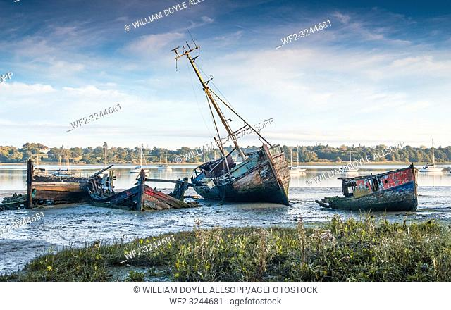 Derelict boats rot on the mud at Pin Mill