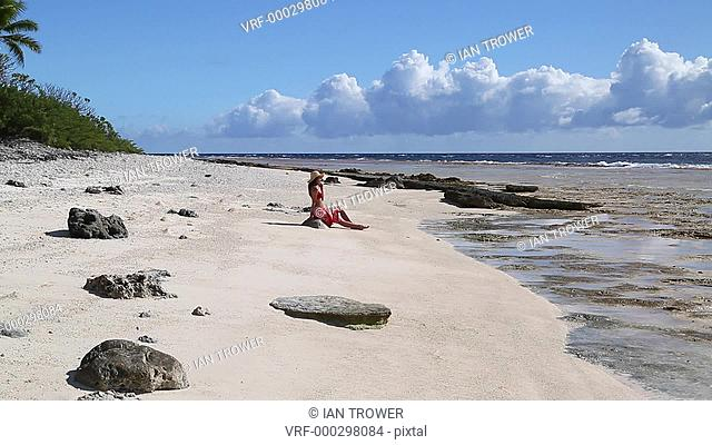 Woman on beach, Fakarava, Tuamotu Islands, French Polynesia