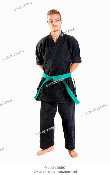Martial arts student isolated in a white background