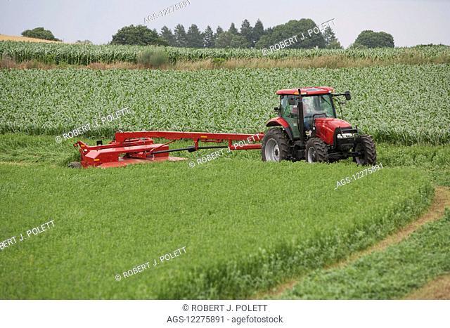 Case IH Tractor with DC132 Disc Mower cutting Alfalfa; Strasburg, Pennsylvania, United States of America