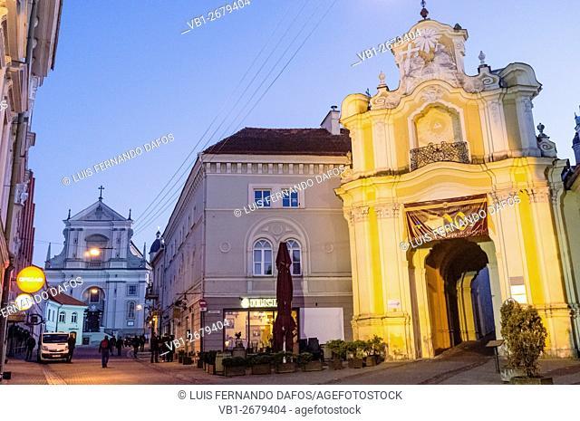 Basilian monastery gates illuminated at dusk. Vilnius, Lithuania, Europe