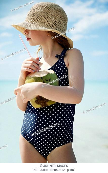 Girl holding coconut