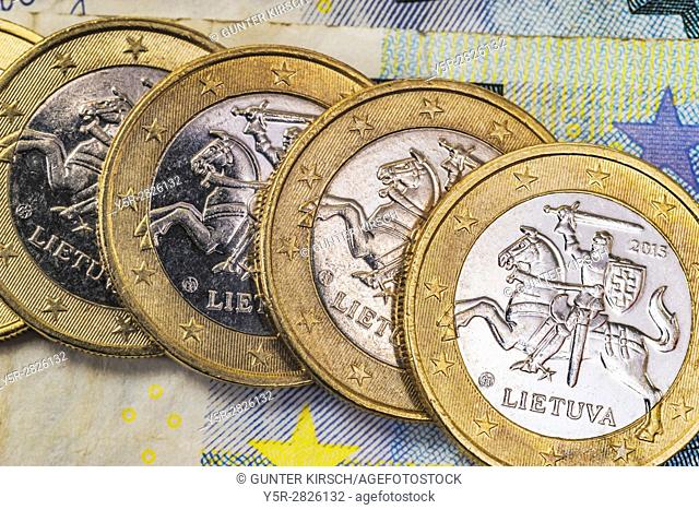 four 1 euro coins from Lithuania on euro banknotes