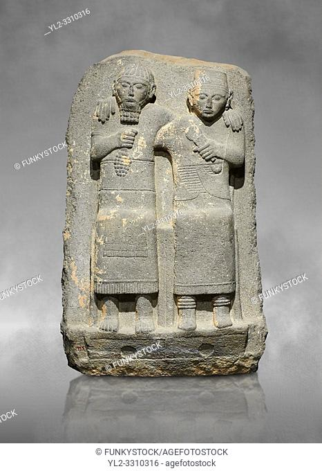 Hittite monumental relief sculpture of of two seated figure, not a typical Hittite style with a lot of other influences. Late Hittite Period - 900-700 BC