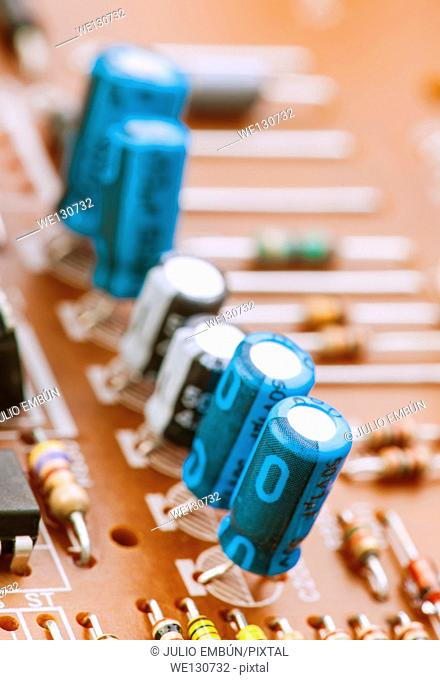 capacitors, resistors and other electronic components mounted on motherboard