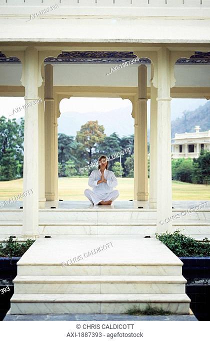 Woman Meditating At Ananda Spa In The Himalayas