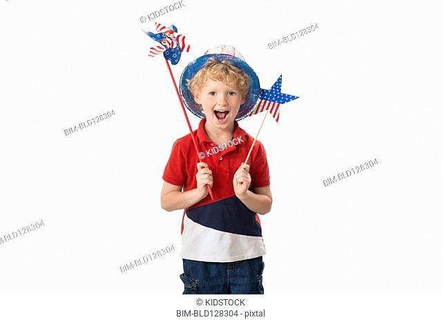 Caucasian boy celebrating Fourth of July