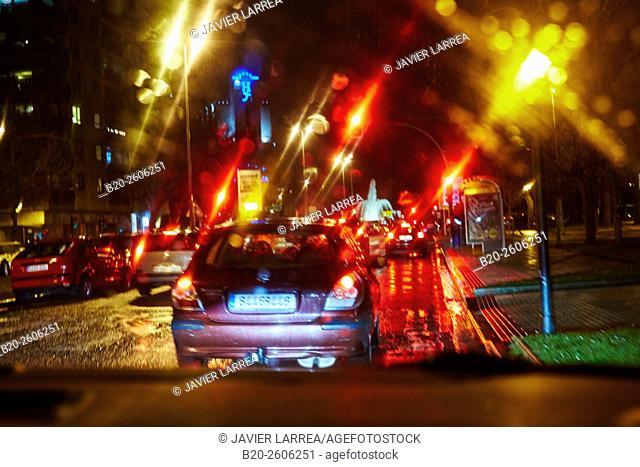 Cars in the city night rain. Donostia. San Sebastian. Gipuzkoa. Basque Country. Spain