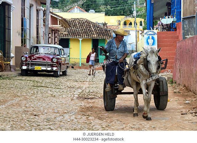 Street with cobblestone, man with donkey, kids, Tnnidad Cuba