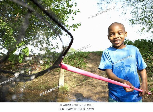 Boy playing with fishing net