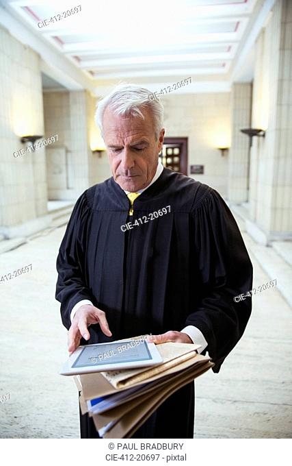 Judge using digital tablet in courthouse