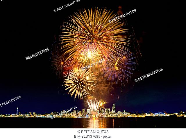 Fireworks exploding over Seattle city skyline, Washington, United States