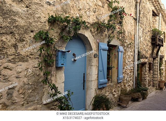 Brightly colored doors and window covers are seen throughout the medieval village of Tourettes sur-Lopp in the south of France