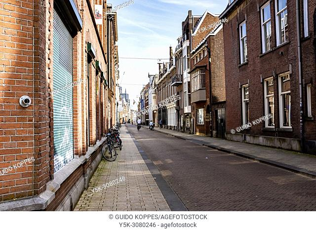 Tilburg, Netherlands. Eastbound view on down town residentisal street Tuinstraat (Gardenstreet) during a spring season sunny day