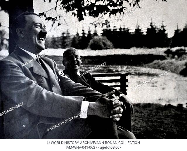 Adolf Hitler 1889-1945. relaxing at a country retreat. German politician and the leader of the Nazi Party driving a car. He was chancellor of Germany from 1933...