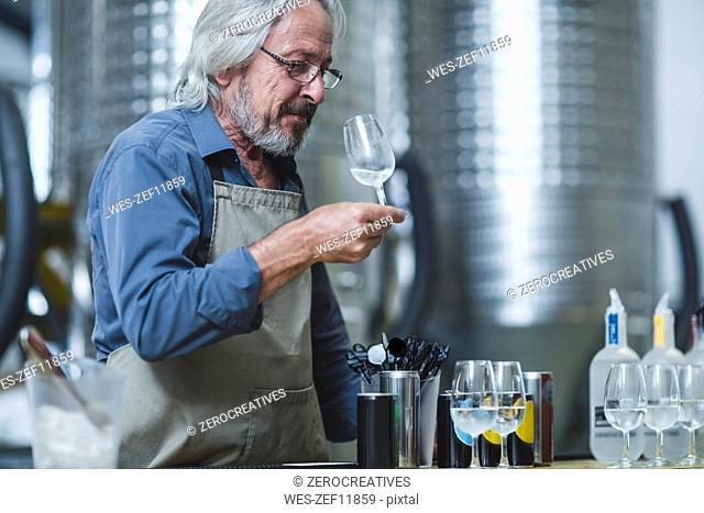 Distiller preparing spirits tasting in distillery