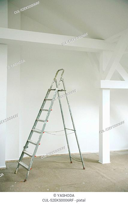 Metal ladder in empty house