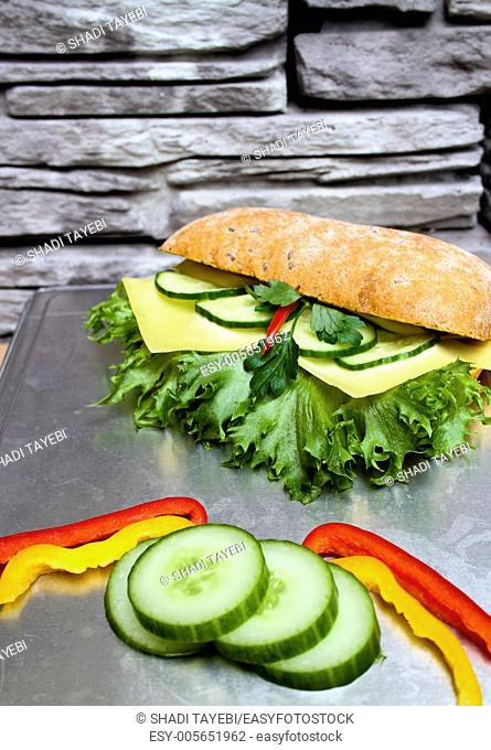 Fresh Sandwich with cucumber, cheese, pepperoni,lettuce,cheese and bread