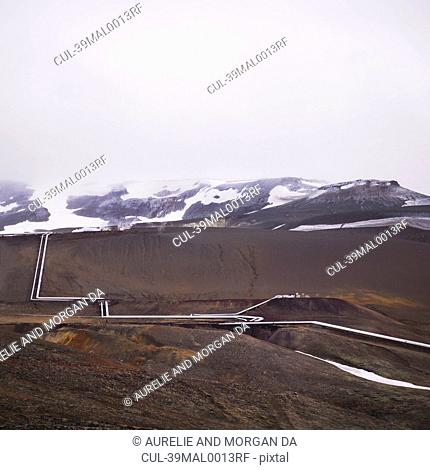 Pipeline winding in rural landscape