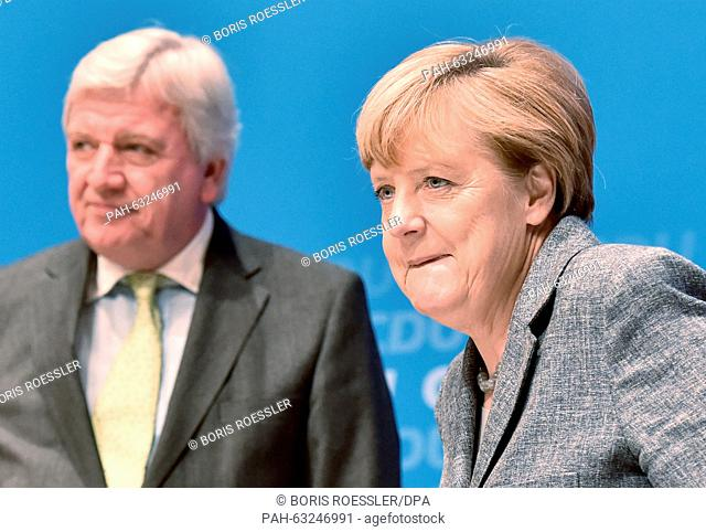 German Chancellor Angela Merkel (CDU, R) and the Premier of Hesse Volker Bouffier (CDU), attend the CDU's conference on future prospects in Darmstadt, Germany