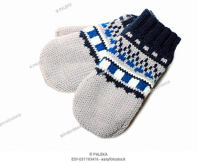 Pair of mitten with ornament on white background