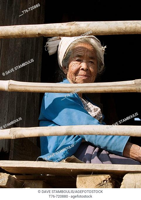 Old Pa O woman sitting on her balcony at Inle Lake in Myanmar