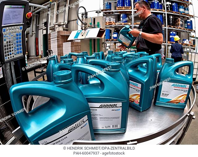 Employee Hendrik Knauf works at the packaging line for engine oil at Addinol Lube Oil GmbH in Leuna, Germany, 08 July 2015