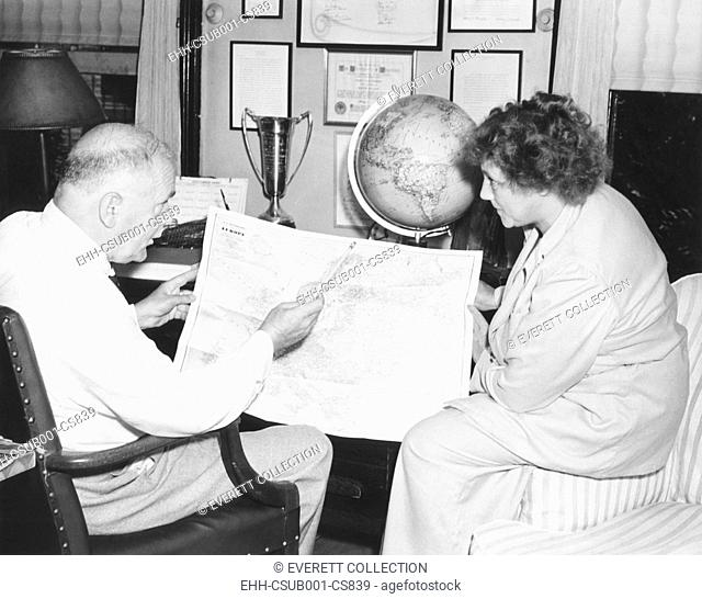 H.V. Kaltenborn charting his itinerary for a three-week aerial tour of Europe. July 1938. His trip coincided with the developing Munich Crisis of 1938