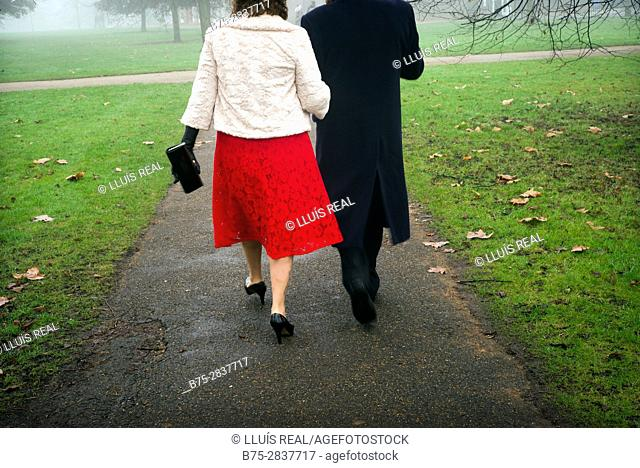 Unrecognizable couple, dressed smartly, walking in Kensington Park Gardens. City of Westminster and Kensington, Chelsea, London, England