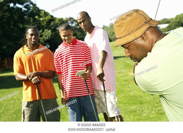African men playing golf