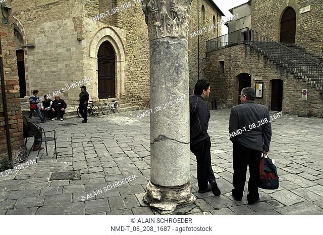 Group of people on the street, Piazza Filippo Silvestri, Bevagna, Umbria, Italy