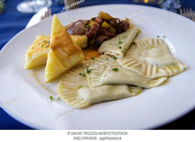 Vegan dinner prepared with polenta ravioli and ratatouille