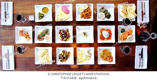 Dining table set up with tapas style food. Seminyak, Indonesia