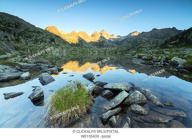 The rocky peaks are reflected in Lago Nero at dawn Cornisello Pinzolo Brenta Dolomites Trentino Alto Adige Italy Europe