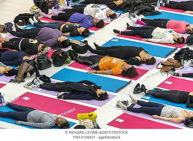Participants in a meditation class in the Westfield World Trade Center mall in New York on Saturday, March 3, 2018. The class was part of the mall's Beauty &...