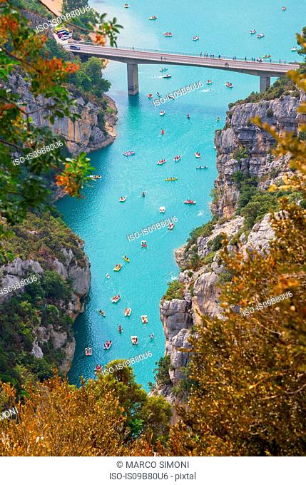Elevated view of people on boats and pedalos, Verdon gorge, Sainte-Croix-du-Verdon, Provence-Alpes-Cote d'Azur, France, Europe