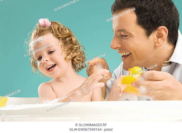 Mid adult man playing with his daughter