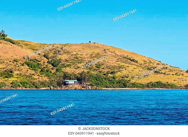 Tiny island with one house on Great Barrier Reef