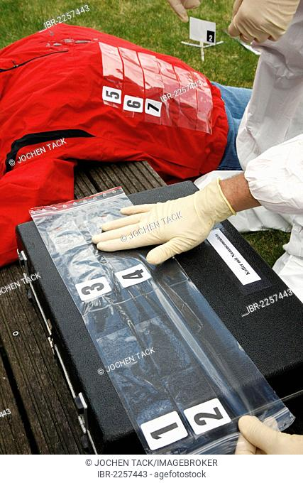 Securing of evidence at a crime scene after a capital offence, murder, homicide, scene of crime officers, crime scene department of the police working at a...