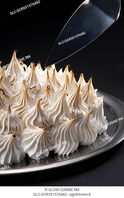 Close-up of a meringue pie with a cake server