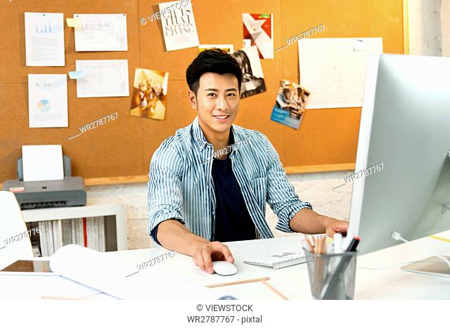 Young man using computer at home
