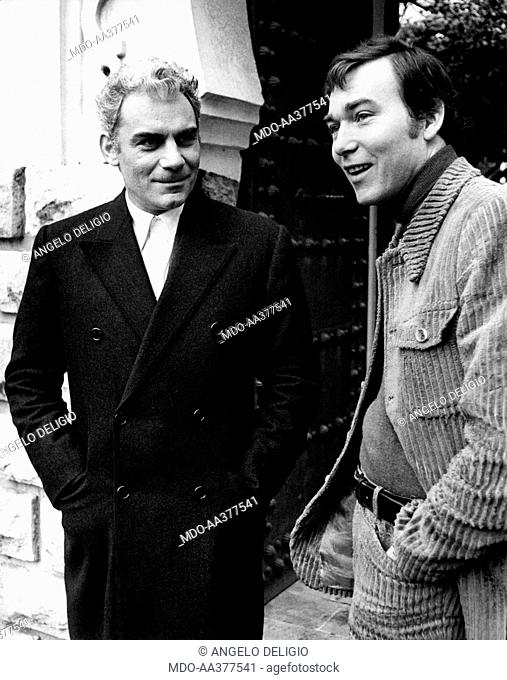 Gian Maria Volonté and Yves Boisset in Plot. Italian actor and scenarist Gian Maria Volonté smiling with French director Yves Boisset on the set of the film...